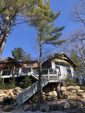 Spring view of Muskoka Soul Cliff Bay luxury rental property on lake muskoka