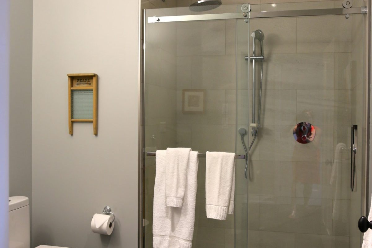 large bathroom with rain shower head, at or muskoka cottage rental, Muskoka Soul