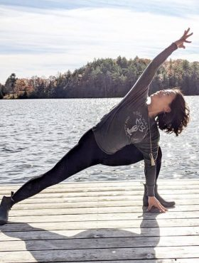 Dock yoga at a muskoka retreat for wellness, health & connecting all at Muskoka Soul in Gravenhurst