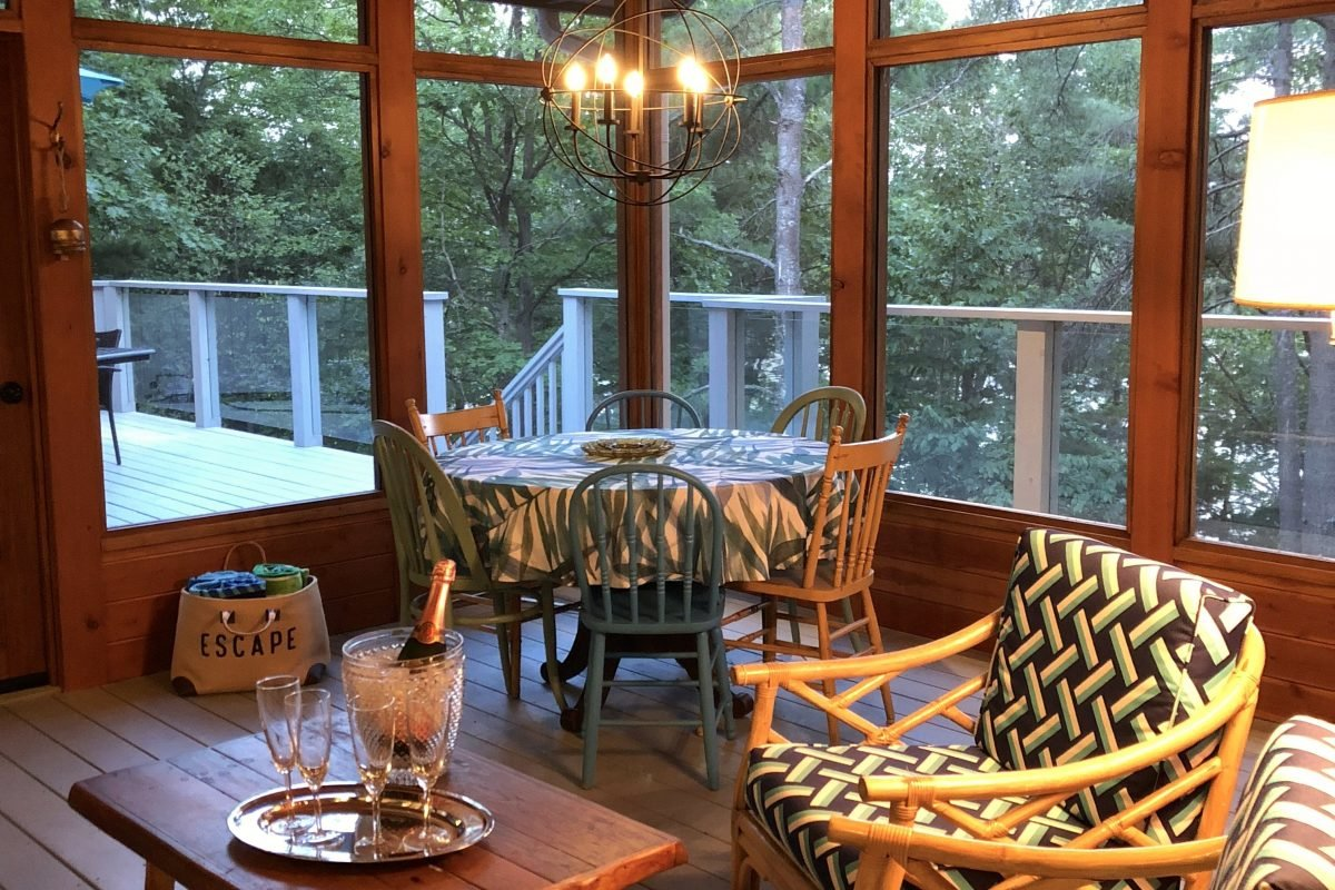 Dine in the Muskoka or the deck at Cliff Bay, muskoka cottage rental