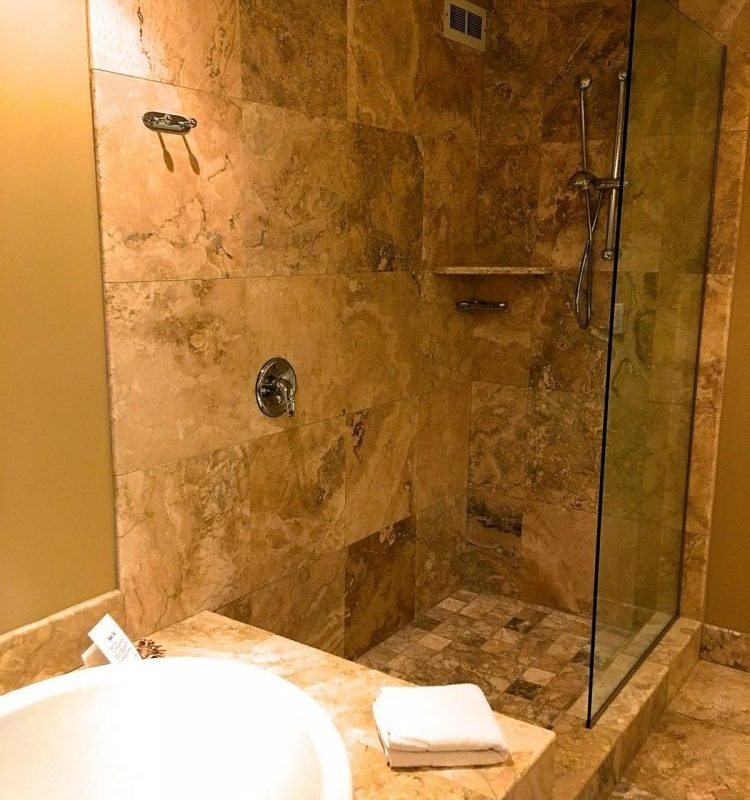 Muskoka Soul spa bathroom has the luxury of a large glass shower and a 6 foot bubble tub